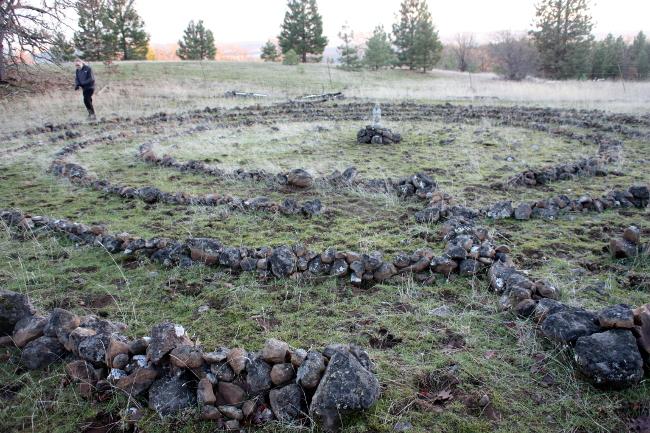 Walker meditating in Herland's stone labyrinth.